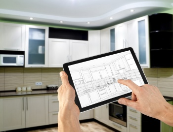 interior layout plan on tablet computer. business. kitchen