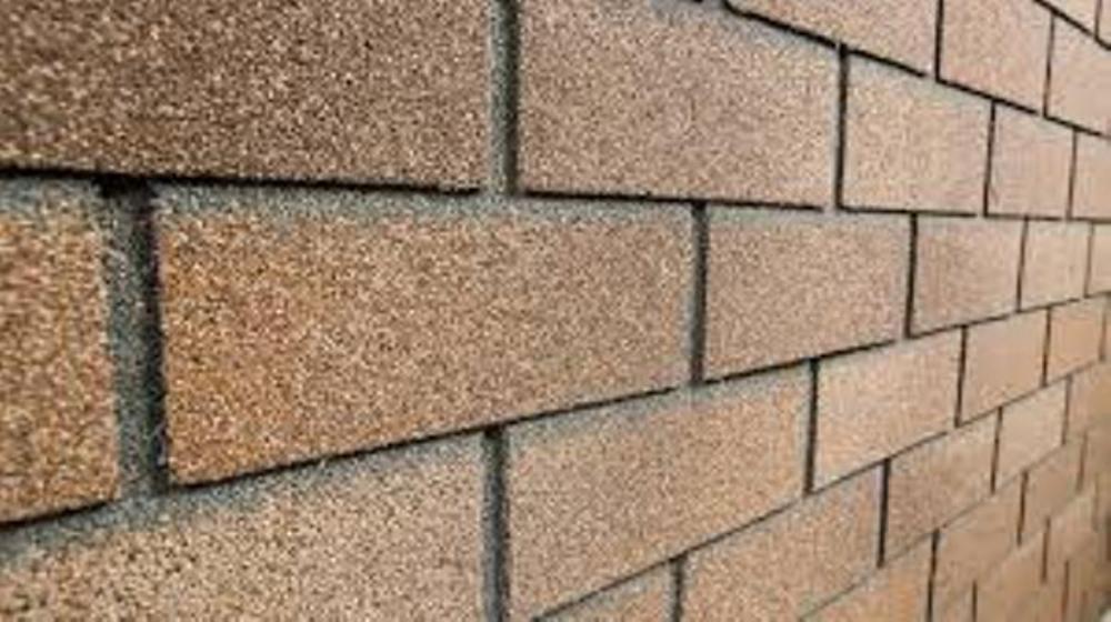 Применение кирпичной кладки и плитки Хауберк для отделки фасадов